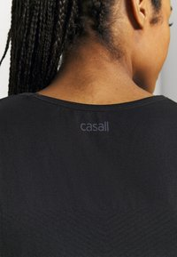 Casall - SEAMLESS BLOCKED TANK - Topper - black - 3