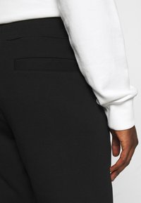 Versace Jeans Couture - Tracksuit bottoms - nero - 7