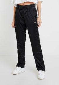 Fila Tall - GERALYN TRACK PANTS - Tracksuit bottoms - black - 0