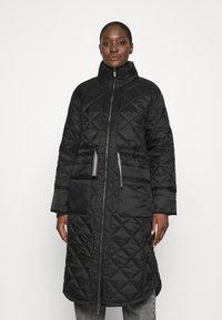 Hunter ORIGINAL - WOMENS REFINED LONG QUILTED COAT - Zimní kabát - black - 0