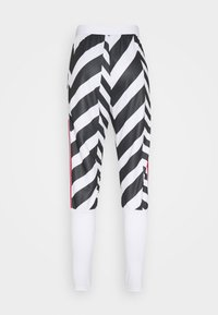 adidas Performance - MANCHESTER UNITED  - Tracksuit bottoms - white/black - 7