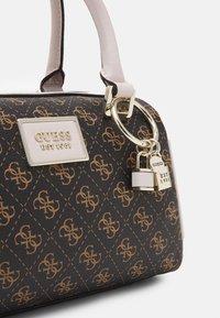 Guess - TYREN BOX SATCHEL - Handbag - brown stone - 3