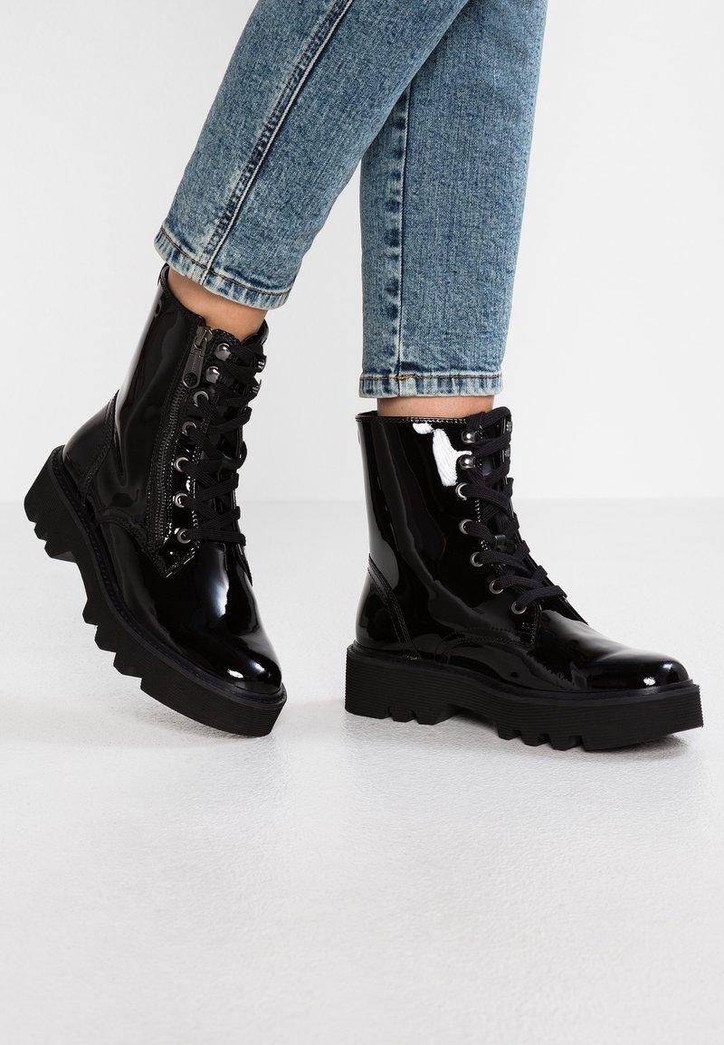 Calvin Klein Jeans - DIAHNE - Platform ankle boots - black