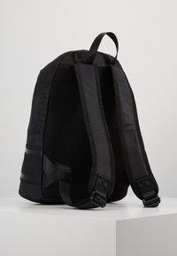 Calvin Klein - STRIPED LOGO ROUND BACKPACK - Rucksack - black - 2