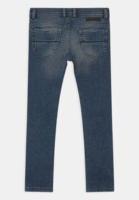 Diesel - THOMMER UNISEX - Slim fit jeans - blue denim - 1