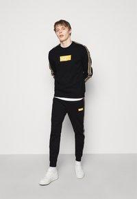 HUGO - DUBESHI  - Sweatshirt - black - 1
