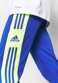 adidas Performance - SQUAD - Tracksuit bottoms - team royal blue/team solar yellow - 3