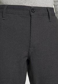 Selected Homme - SLHSLIM STORM FLEX SMART PANTS - Trousers - dark grey - 3