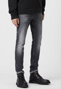 AllSaints - Slim fit jeans - black - 1