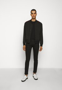 HUGO - Slim fit jeans - black - 1