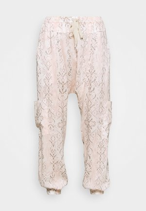 RISE TO THE SUN PRINTED - Tracksuit bottoms - pink