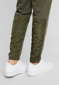 Urban Classics - MILITARY - Tracksuit bottoms - olive - 4