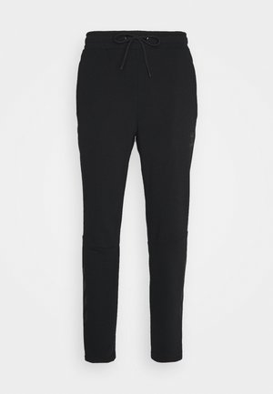 HMLISAM TAPERED - Tracksuit bottoms - black