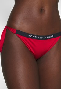 Tommy Hilfiger - CORE SOLID LOGO CHEEKY SIDE TIE - Bikini bottoms - primary red - 3