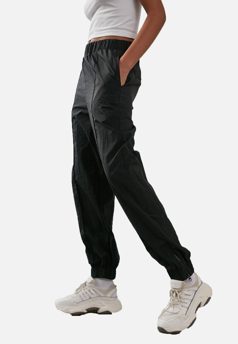 NA-KD - Tracksuit bottoms - black