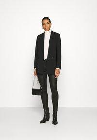 Calvin Klein Jeans - MOTO COATED MILANO  - Leggings - Trousers - black - 1