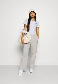 Missguided - PLAYBOY VARSITY BODYSUIT - Polo shirt - grey - 1