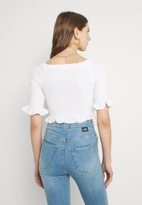 Glamorous - SMOCKED BARDOT WITH 1/2 SLEEVES AND FRILL HEMS - Print T-shirt - off white - 2