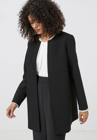 HALLHUBER - Short coat - black - 2