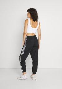adidas Originals - TRACK PANTS - Spodnie treningowe - black - 2
