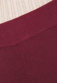 NA-KD - FLARED LOUNGE PANTS - Tracksuit bottoms - burgundy - 5