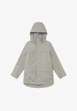 REIMATEC BOCK - Waterproof jacket - stone beige