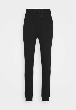 JOGGER LABEL UNISEX - Tracksuit bottoms - black