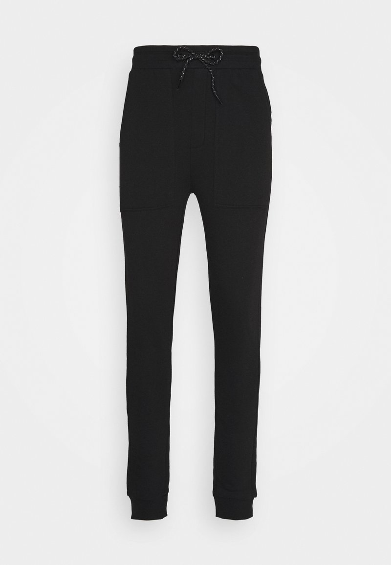 RETHINK Status - JOGGER LABEL UNISEX - Tracksuit bottoms - black