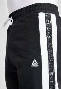Reebok - MEET YOU THERE TRAINING 7/8 JOGGER PANTS - Tracksuit bottoms - black - 5