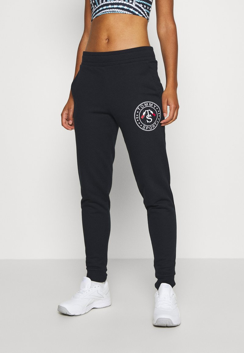 Tommy Hilfiger - CUFF GRAPHIC  - Tracksuit bottoms - blue