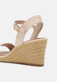 Tamaris - Wedge sandals - cream - 5