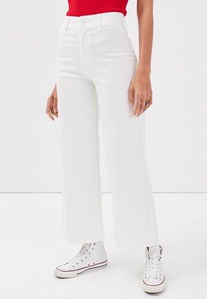 Flared Jeans - ecru