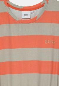 BOSS Kidswear - Jersey dress - coral - 2