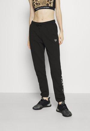 LYON - Spodnie treningowe - black