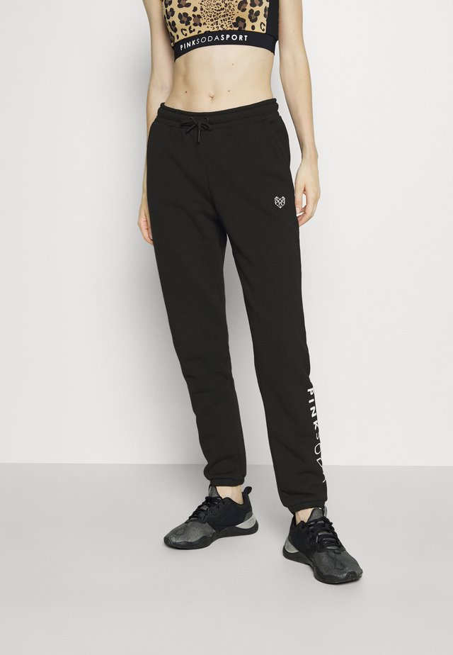 LYON - Tracksuit bottoms - black