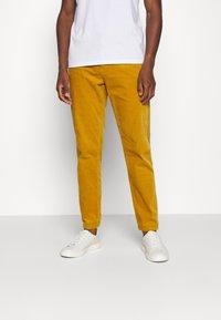 Lindbergh - CORD TROUSERS - Trousers - dark yellow - 0