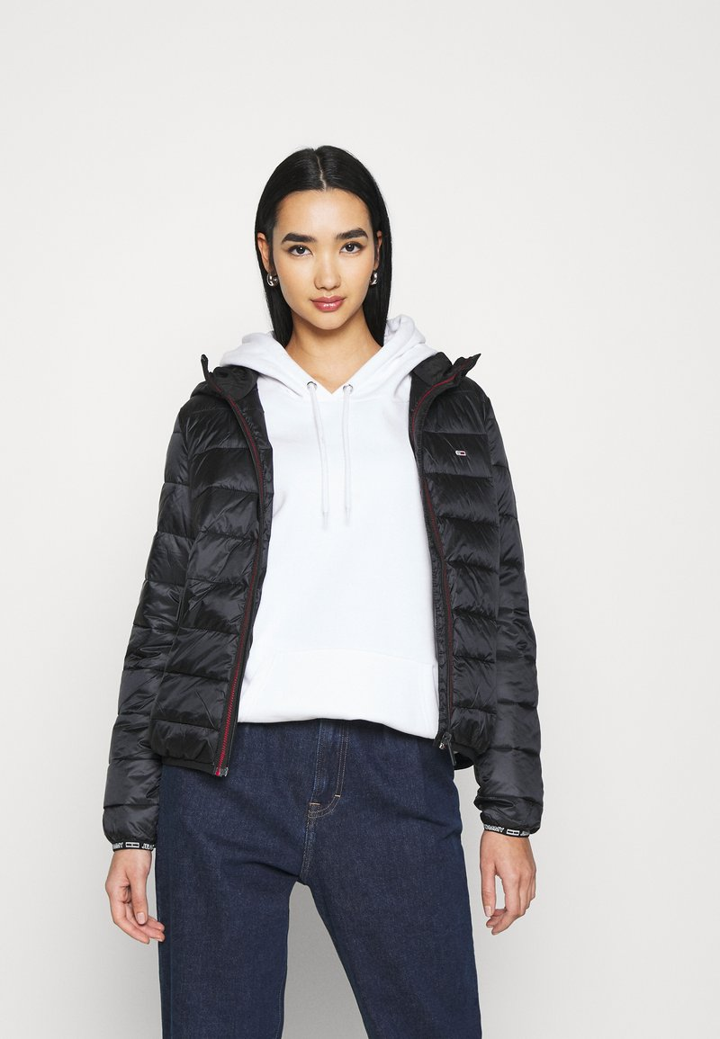 Tommy Jeans - TJW QUILTED TAPE HOODED JACKET - Light jacket - black