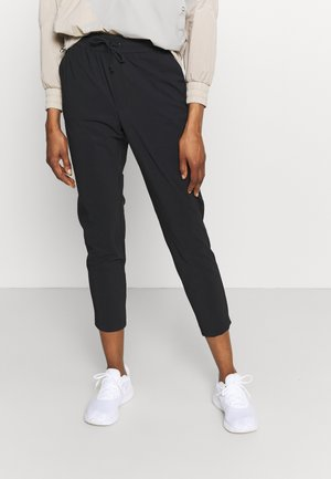 ANY PANT - Verryttelyhousut - black