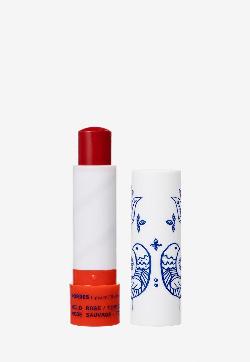 Korres - WILD ROSE LIP BALM - Lip balm - red