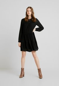 Vero Moda - VMCAITLIN SHORT DRESS - Day dress - black - 1