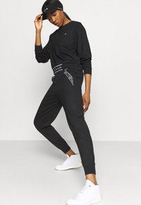 Calvin Klein Performance - PANTS - Tracksuit bottoms - black - 4