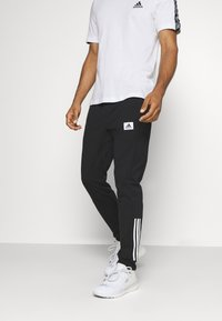 adidas Performance - AEROREADY TRAINING SPORTS PANTS - Teplákové kalhoty - black/white - 0