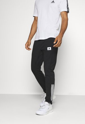 AEROREADY TRAINING SPORTS PANTS - Tracksuit bottoms - black/white