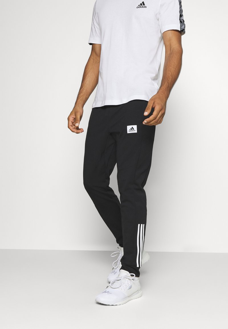 adidas Performance - AEROREADY TRAINING SPORTS PANTS - Teplákové kalhoty - black/white