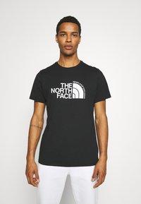 The North Face - CURVED EXPLORATION TEE - Triko spotiskem - black - 0