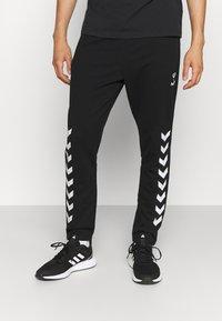 Hummel - RAY 2.0 TAPERED PANTS - Spodnie treningowe - black - 0