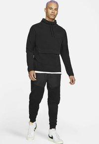Nike Sportswear - M NSW TCH FLC LS FNL - Sweatshirt - black/black - 1