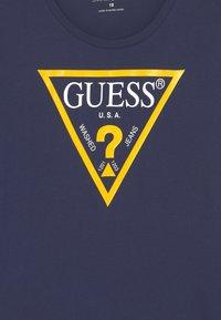 Guess - JUNIOR CORE - Top sdlouhým rukávem - deck blue - 2