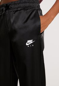 Nike Sportswear - AIR PANT - Tracksuit bottoms - black - 4
