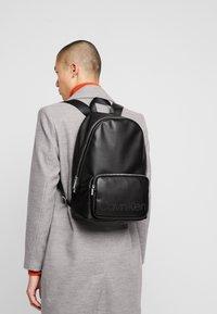 Calvin Klein - PUNCHED ROUND  - Rucksack - black - 1